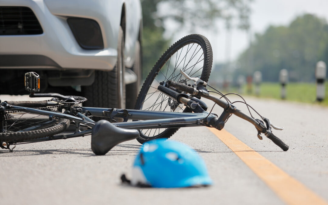 Accident car crash with bicycle and helmet on road